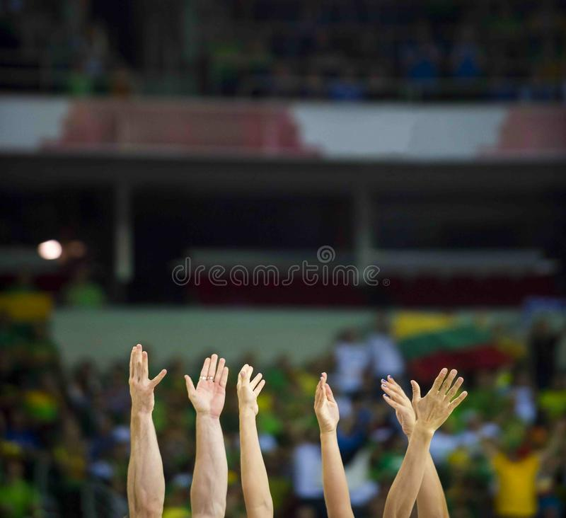 Fans clapping on the podium of the stadium stock photos