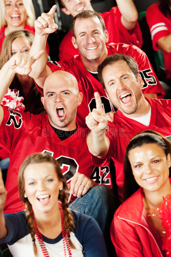 Fans: Crowd of Fans Excited for Team. Extensive series of a crowd of fans inside a stadium watching their favorite football team. Wearing team jerseys, having royalty free stock photos
