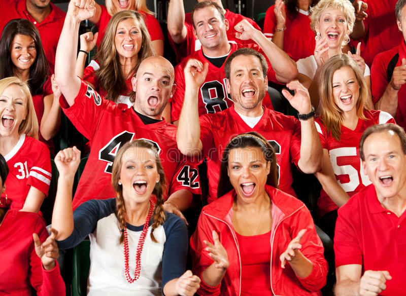Fans: Excited Crowd Cheering for Team. Extensive series of a crowd of fans inside a stadium watching their favorite football team. Wearing team jerseys, having royalty free stock photography