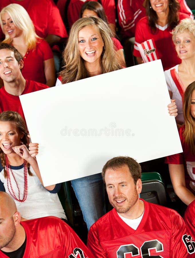 Fans : La femme mignonne retarde le signe vide photographie stock