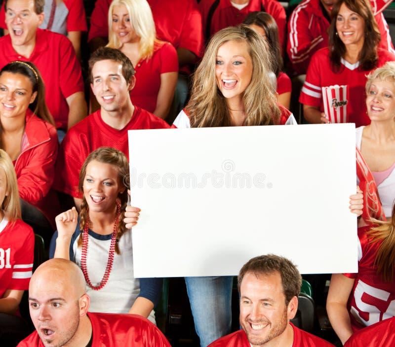 Fans : Le fan féminin retarde le signe vide photographie stock