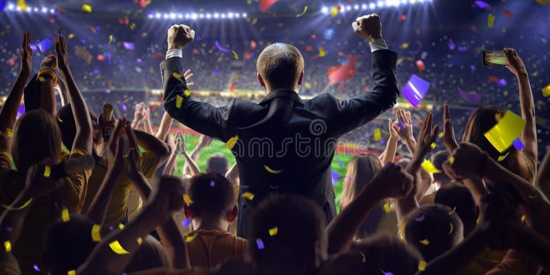 Fans på stadionlekaffärsman royaltyfria foton