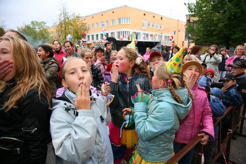 Fans of the popular star, adults and children listeners a free street concert Bravo applaud, rejoice and dance. Concert an old rocker, a popular singer, star of royalty free stock image