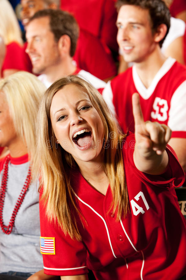 Fans: Pretty Baseball Fan Cheers for Team. Extensive series of a crowd of baseball fans, sitting in a stadium. Having fun, cheering, etc royalty free stock image