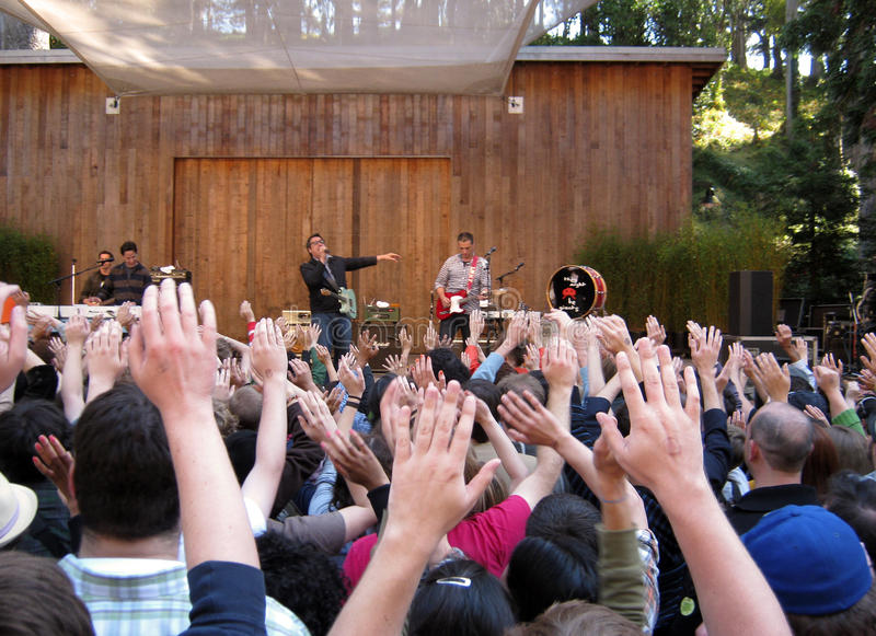 Fans raise hands at concert by They Might Be Giant royalty free stock photos