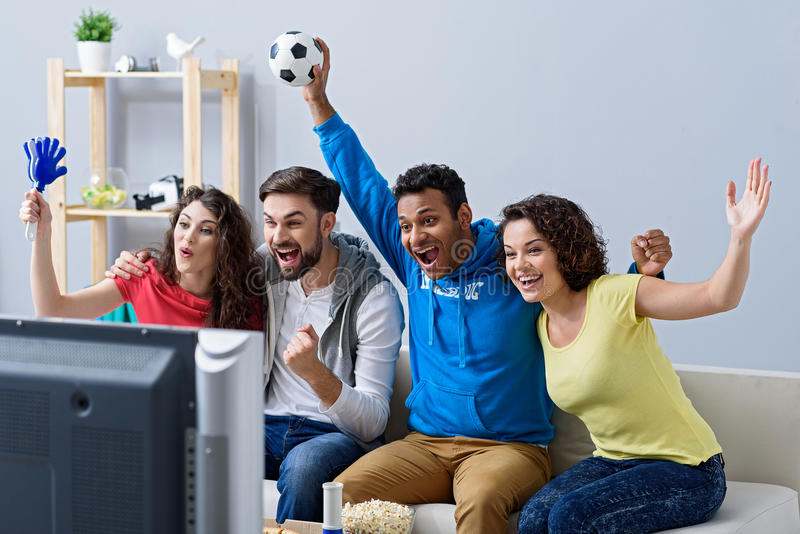 Fans of soccer watching match stock photography