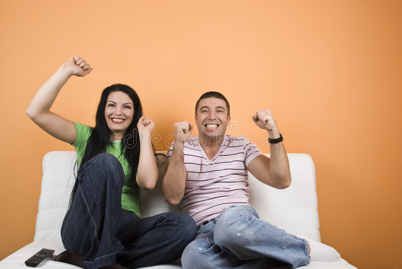 Fans sport team watching TV royalty free stock image
