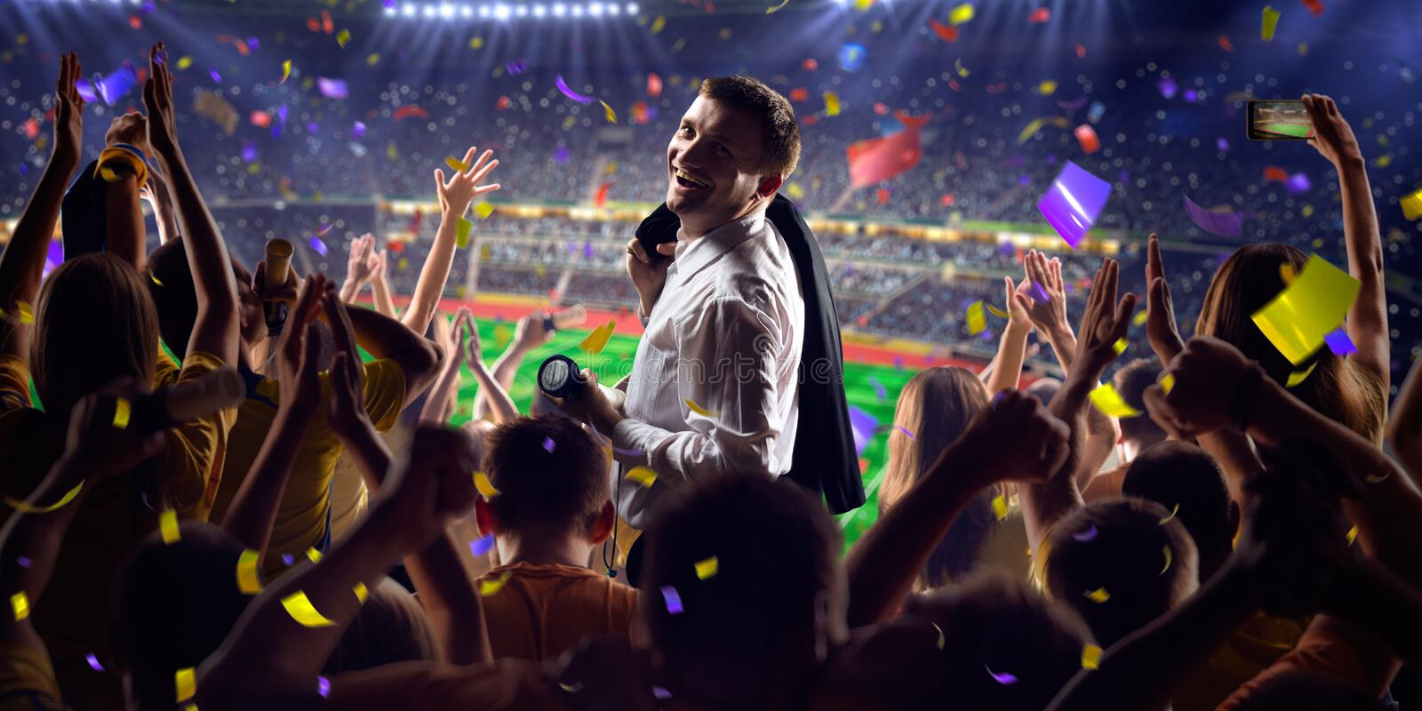 Fans on stadium game businessman. Fans on stadium soccer game Confetti and tinsel royalty free stock image