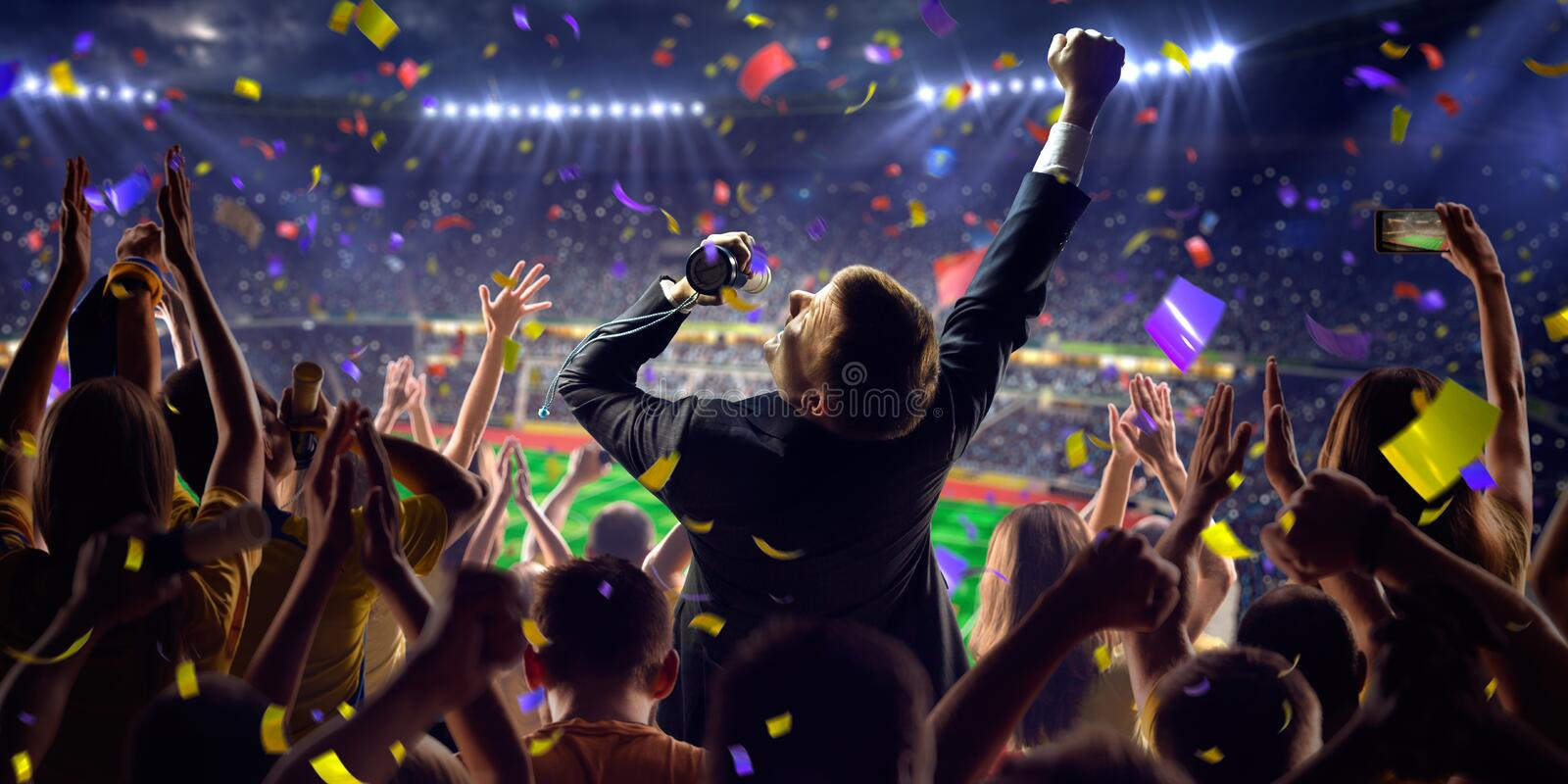 Fans on stadium game businessman. Fans on stadium soccer game Confetti and tinsel stock image