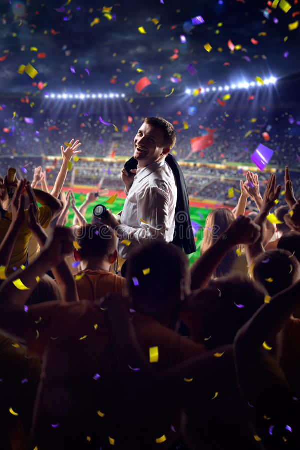 Fans on stadium game businessman. Fans on stadium soccer game Confetti and tinsel stock photography