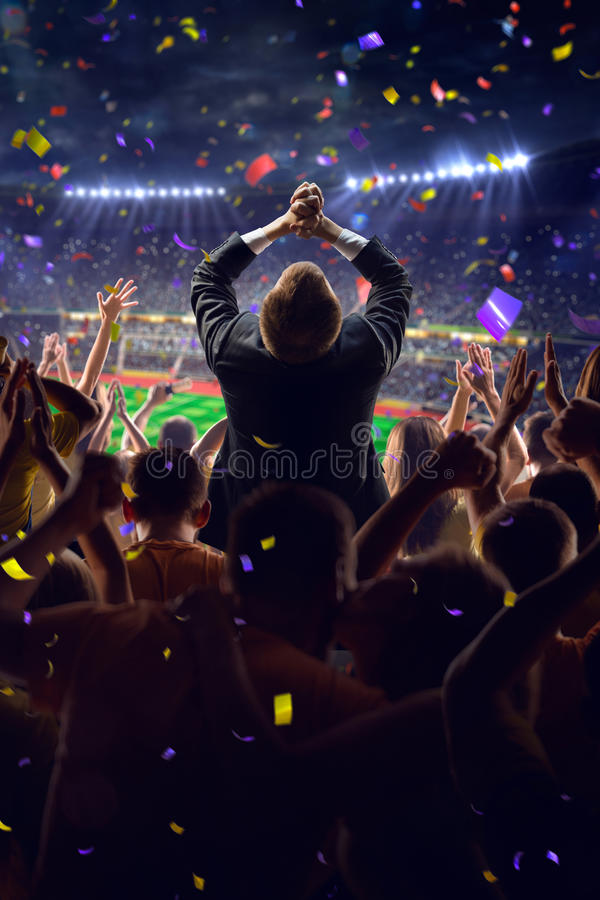 Fans on stadium game businessman. Fans on stadium soccer game Confetti and tinsel royalty free stock images