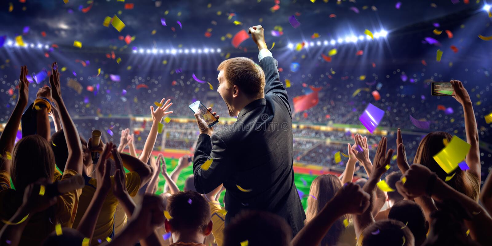 Fans on stadium game businessman. Fans on stadium soccer game Confetti and tinsel stock photos