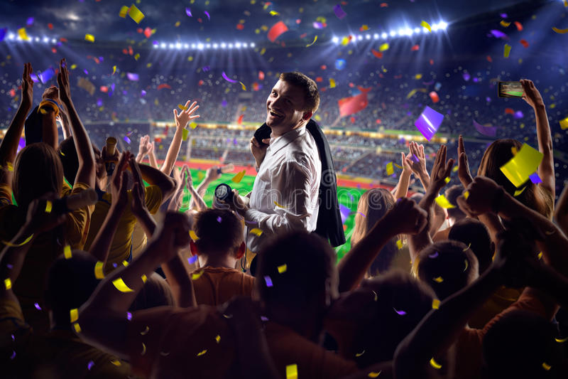 Fans on stadium game businessman. Fans on stadium soccer game Confetti and tinsel royalty free stock photo