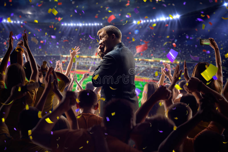 Fans on stadium game businessman. Fans on stadium soccer game Confetti and tinsel royalty free stock photos
