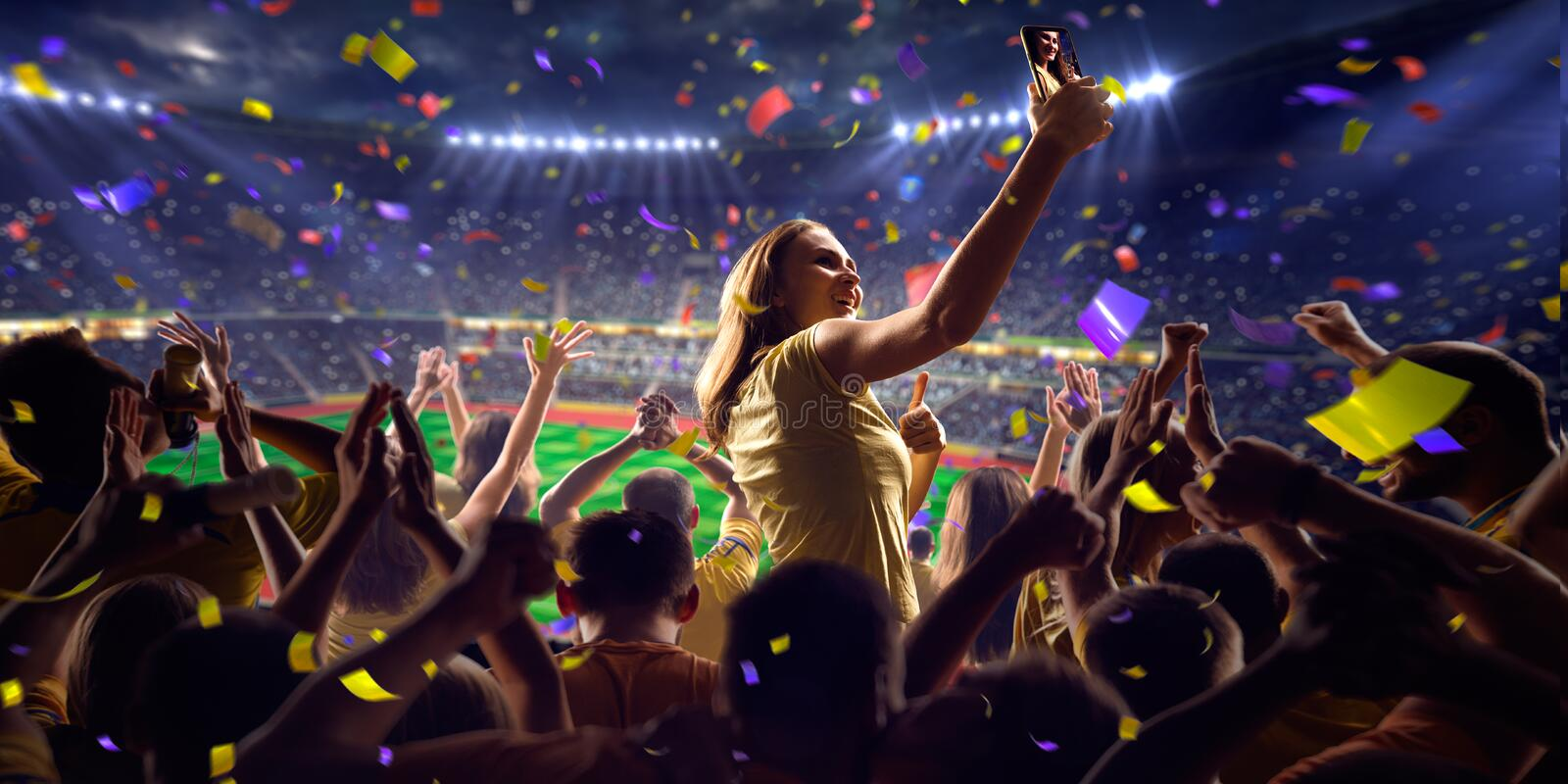 Fans on stadium game panorama view. Fans on stadium soccer game Confetti and tinsel royalty free stock image