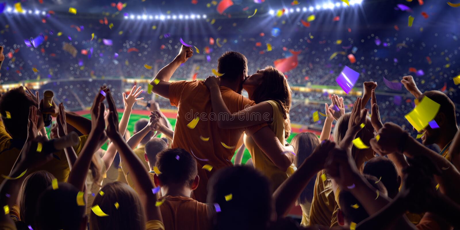 Fans on stadium game panorama view. Fans on stadium soccer game Confetti and tinsel stock photo