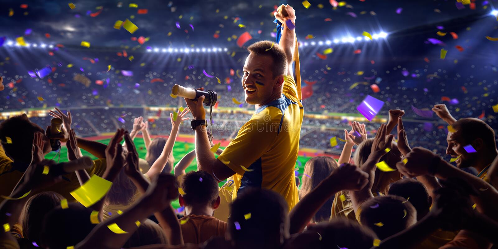 Fans on stadium game panorama view. Fans on stadium soccer game Confetti and tinsel stock image