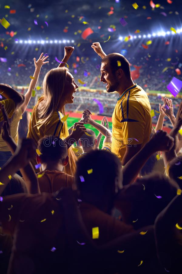 Fans on stadium game. Fans on stadium soccer game Confetti and tinsel stock image