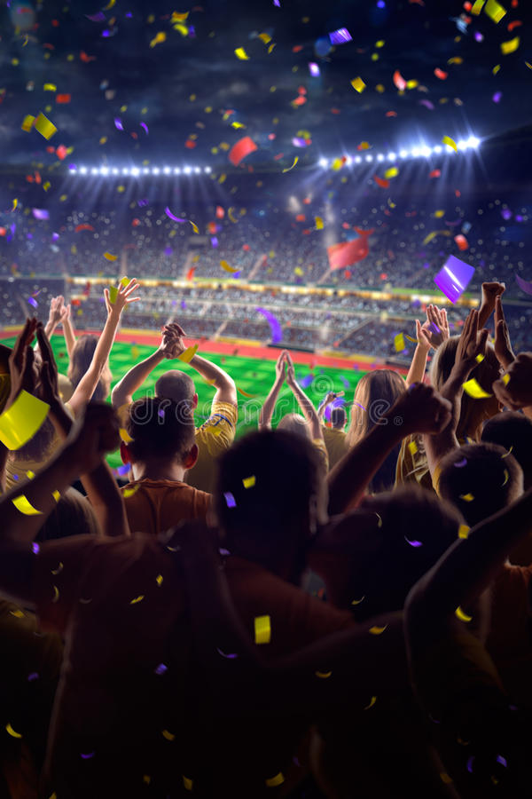 Fans on stadium game. Fans on stadium soccer game Confetti and tinsel royalty free stock photography