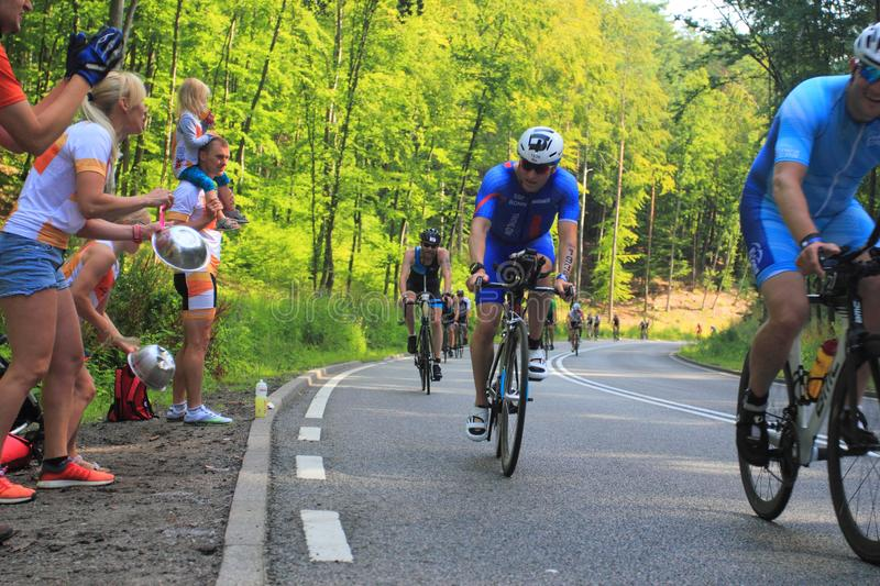Fans supporting cyclists on race route stock photo