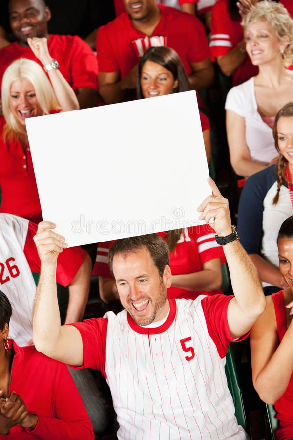 Fans: Team Fan Holds Up Blank Sign. Extensive series of a crowd of baseball fans, sitting in a stadium. Having fun, cheering, etc stock photography
