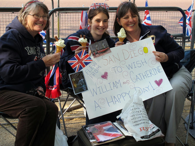 Fans from United States. Three fans of the royal wedding between Prince William and Kate Middleton waiting for the big event. They came from San Diegoand were stock image