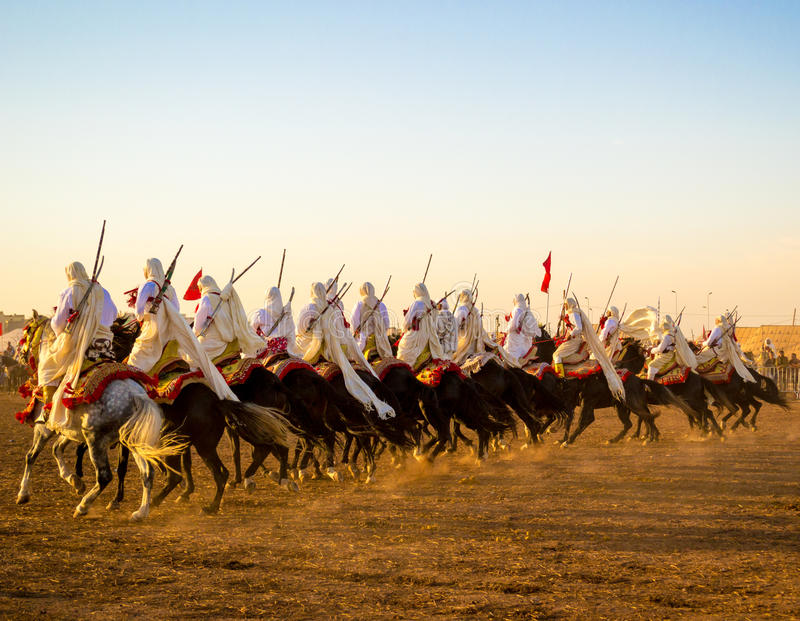Fantasia riders row. Photo taken in Morocco. Fantasia is a traditional exhibition of horsemanship in the Maghreb performed during cultural festivals and to close stock photography