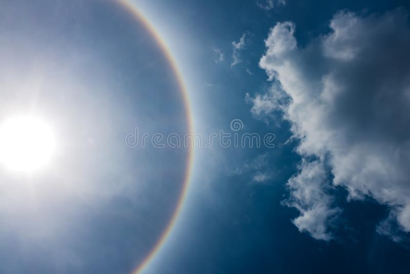Fantastic beautiful sun halo phenomenon. Serenity nature. Fantastic beautiful sun halo phenomenon. Landscape of sky and circular rainbow around the sun royalty free stock photos