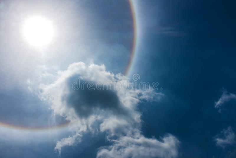Fantastic beautiful sun halo phenomenon. Serenity nature. Fantastic beautiful sun halo phenomenon. Landscape of sky and circular rainbow around the sun royalty free stock images