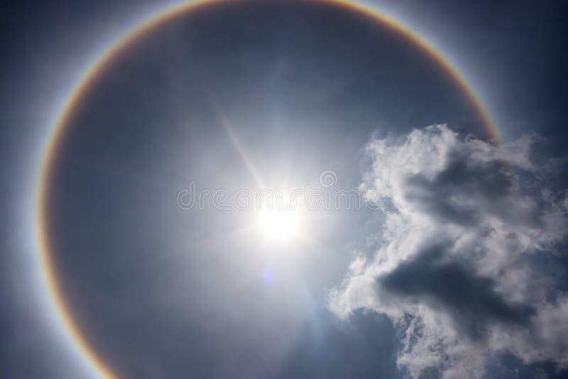 Fantastic beautiful sun halo phenomenon. Serenity nature. Fantastic beautiful sun halo phenomenon. Landscape of sky and circular rainbow around the sun stock images