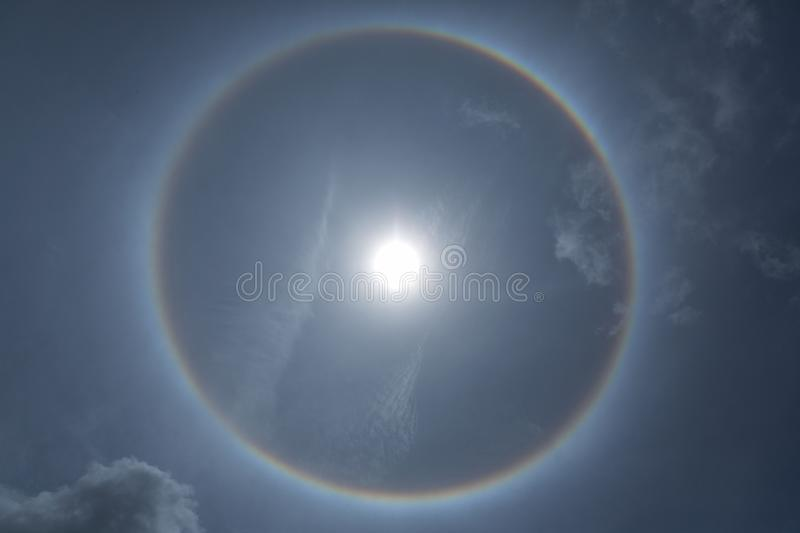 Fantastic beautiful sun halo phenomenon or the sun with circular. Rainbow. optical phenomenon royalty free stock photography