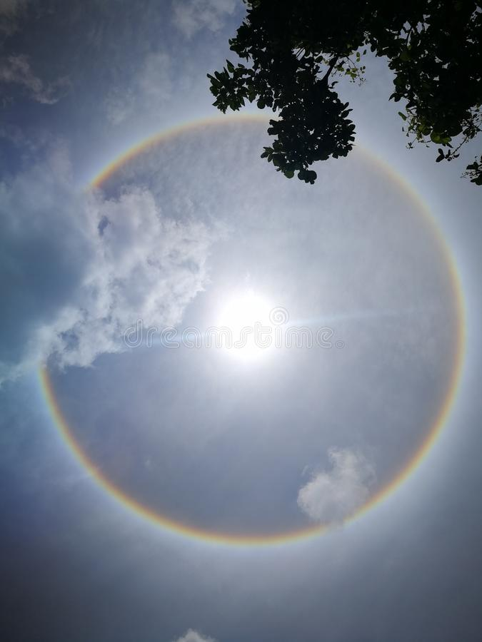 Fantastic beautiful sun halo phenomenon in Thailand. Or the sun with circular rainbow royalty free stock photos