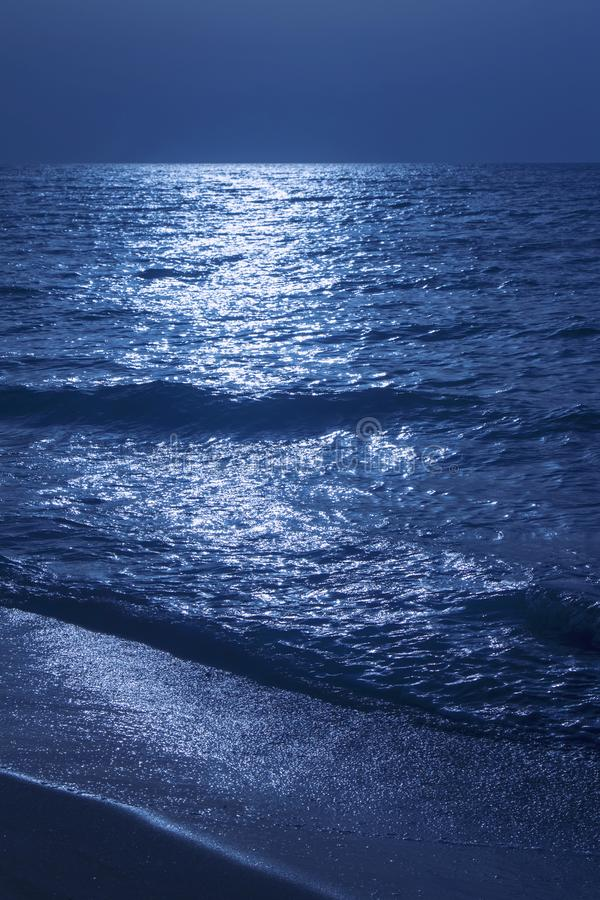 Fantastic blue sea background. Mediterranean Sea at night. Moon. Reflecting in a sea stock images