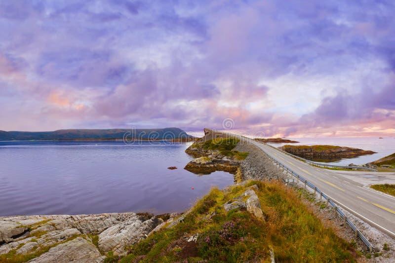 Fantastic bridge on the Atlantic road in Norway. Fantastic bridge through fjord on the Atlantic road in Norway - travel background stock photo