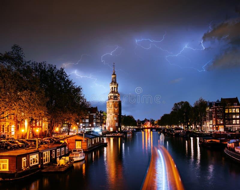 Fantastic collage. Beautiful lightning. Night in Amsterdam. royalty free stock photos