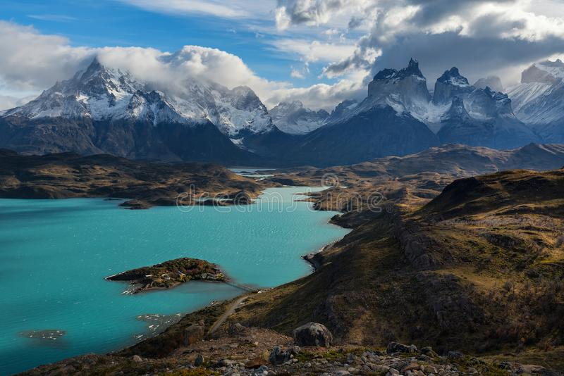 The fantastic color of the lake water is Pehoé`s surface water body located in Torres del Paine National Park royalty free stock images