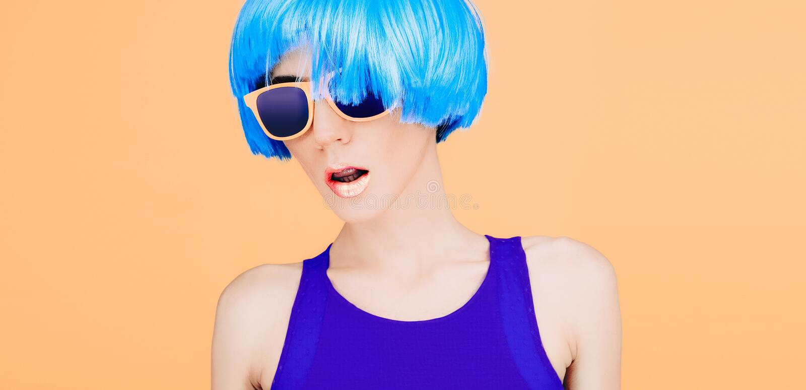 Fantastic fashion lady in blue wig and glasses stock photography
