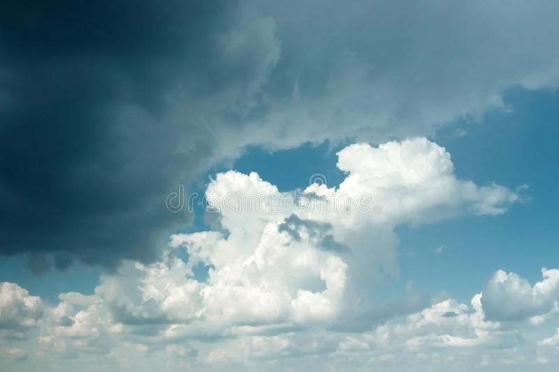 Fantastic, fluffy, white clouds against a blue sky. Rain clouds. The situation in the sky before the storm. copy space royalty free stock image