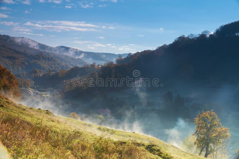 Fantastic foggy day and bright Dramatic morning scenery. Carpathian, Ukraine, Europe. royalty free stock photos