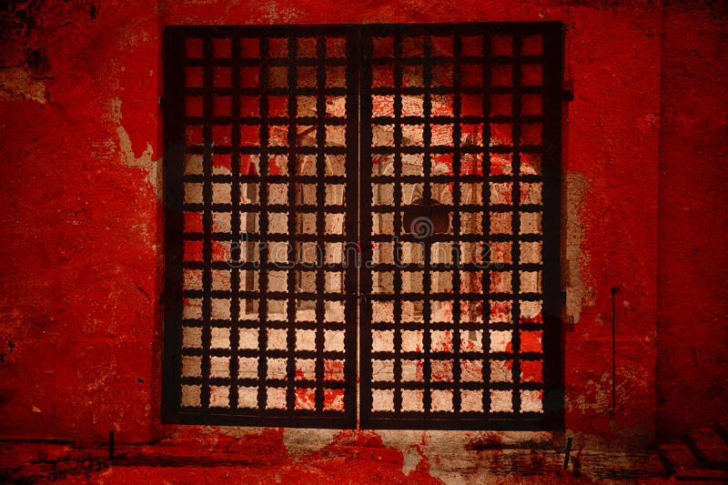 Fantastic gate. The gate to hell. Double exposure, beautiful big vintage metal gate and red texture vintage wall. Artistic creative processing stock image
