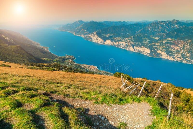 Fantastic Lake Garda view from the Baldo mountains, Italy, Europe. Spectacular alpine lake with high mountains. Wonderful Garda lake view from the Monte Baldo royalty free stock photos