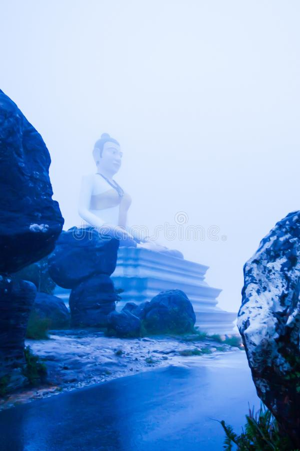 Fantastic landscape of Lok Yeay Mao Monument in foggy, the monument was constructed atop Bokor Mountain, Kampot, Cambodia. Soft focus, fantastic landscape of Lok royalty free stock images