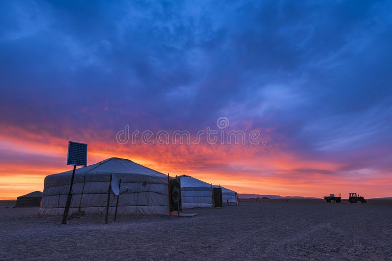 Fantastic Mongolian dawn overlooking the yurt - the traditional dwellings of nomads. royalty free stock photography