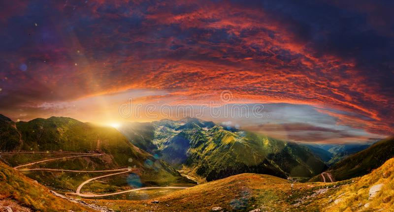 Fantastic mountain scenery. majestic sunset with dramatic sky. Colorful blooden clouds in the sky royalty free stock photography