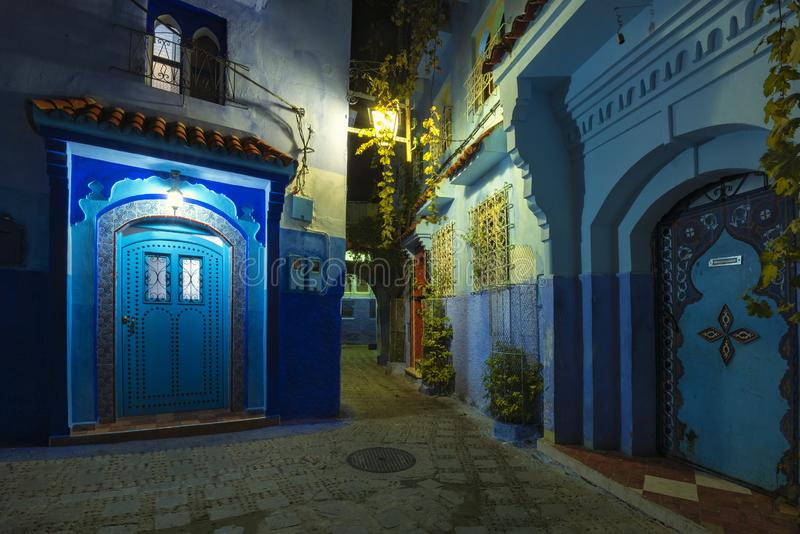 Beautiful night view of the blue city in the medina of Chefchaouen, Morocco. Fantastic night view at traditional moroccan architectural details.  Blue street royalty free stock images