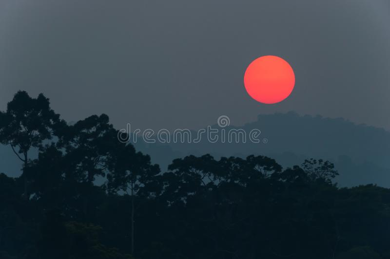 Fantastic the red sun setting above the deep jungle and mountain range. Khao Yai, Thailand stock images