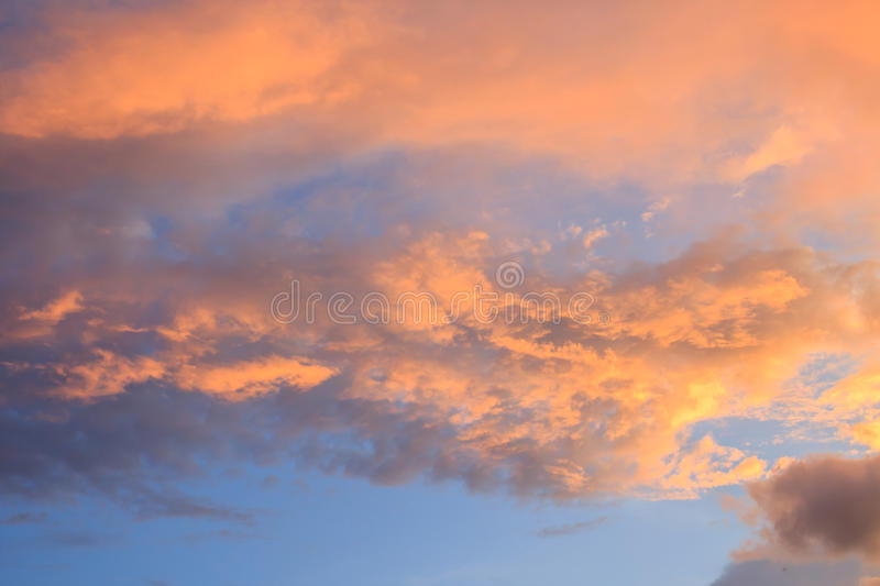 Fantastic red sunset and dark ominous clouds stock images