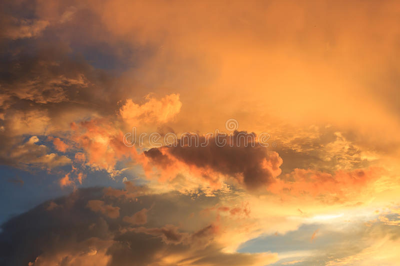 Fantastic red sunset and dark ominous clouds royalty free stock images