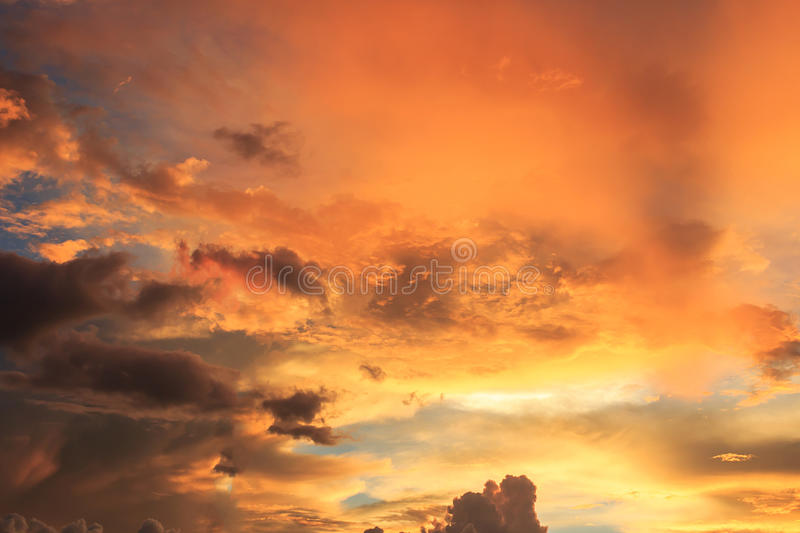 Fantastic red sunset and dark ominous clouds stock photography