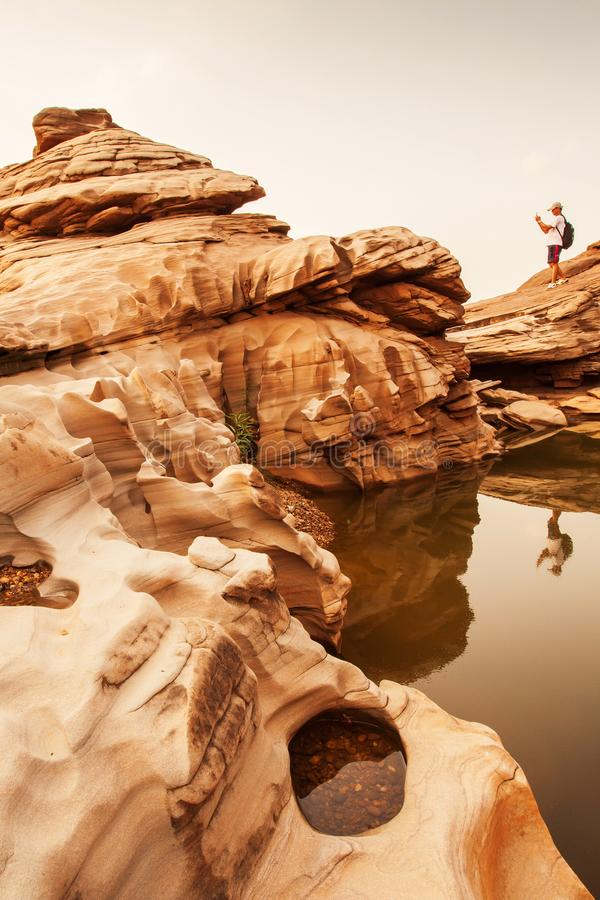 Fantastic scenery of steep sandstone of the Mekong River at dusk, amazing shape of steep sandstone in summer stock image